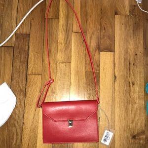 Red clutch crossbody bag